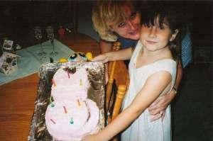 My Daughter with Cat Cake (c) copyright Sherri Matthews 2013