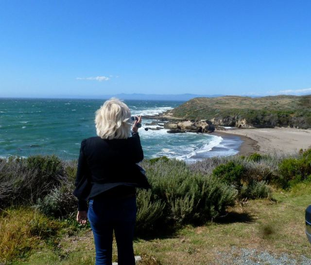 Photo taken by my friend of me filming the beautiful Pacific ocean (c) Sherri Matthews 2014