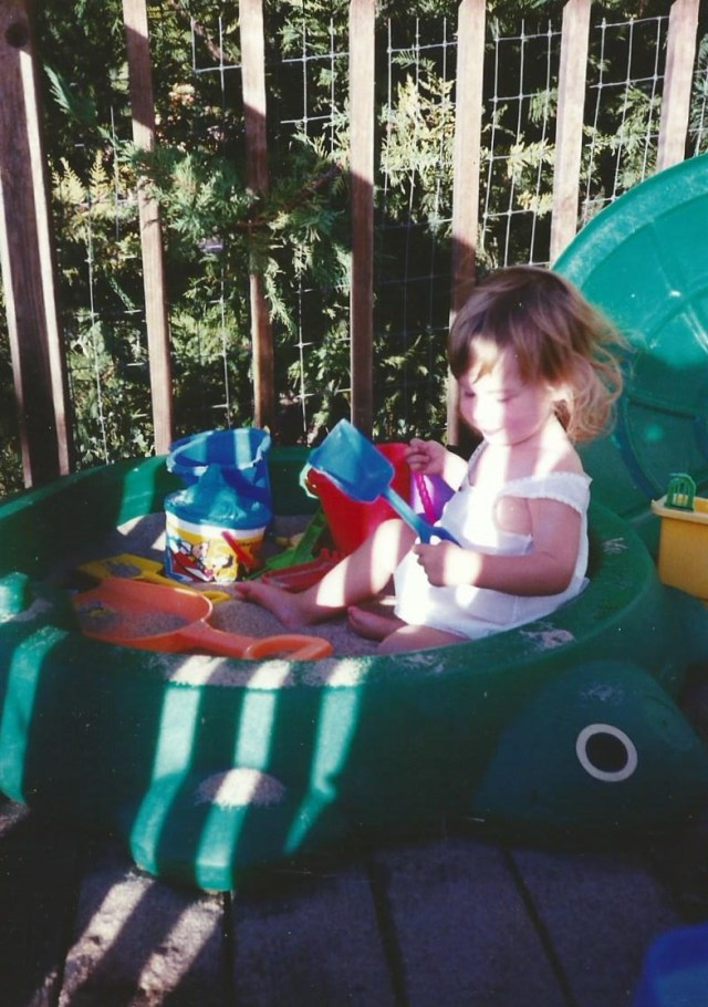 My daughter playing in her sandbox - 1994 (c) Sherri Matthews 2014