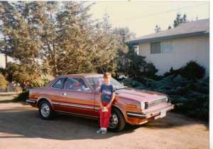 1988. Eldest son standing next to one of our better cars, a Honda Prelude.  I loved it but when Nicky arrived, it was very difficult getting a baby-seat in the back with only two doors.  (c) Sherri Matthews 2014