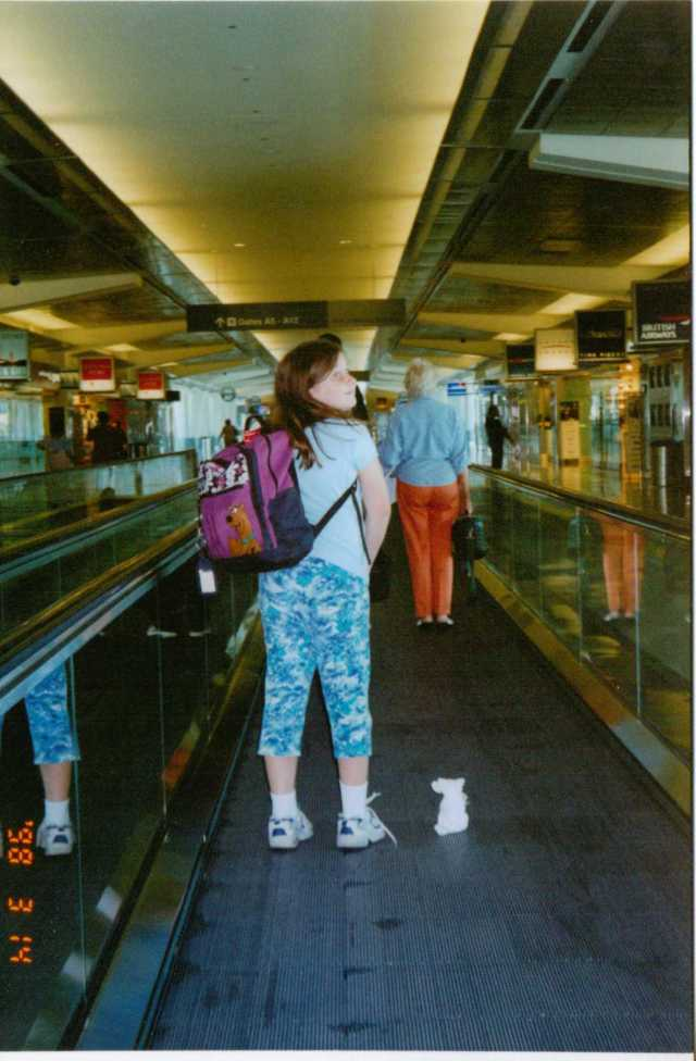 Aspie D on the moving walkway at San Francisco Airport, 2003.  What new life awaits? (c) Sherri Matthews 2014