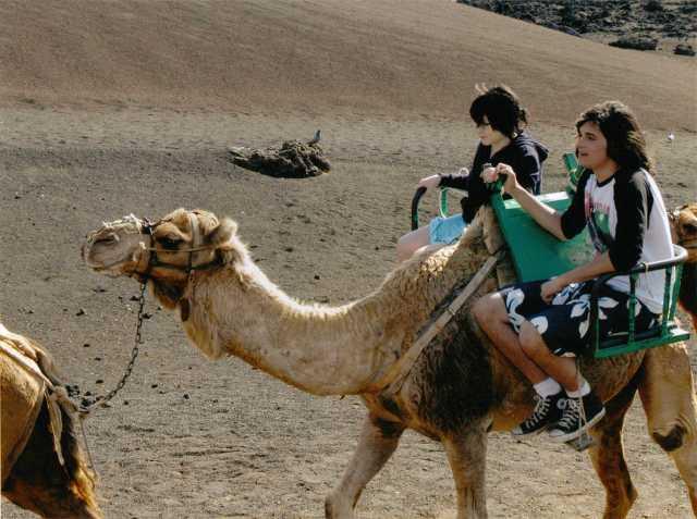 Aspie D & Nicky on a hair-raising camel ride.  Not Morroco, no, but Lanzarotte believe it or not!  2008 (c) Sherri Matthews 2014