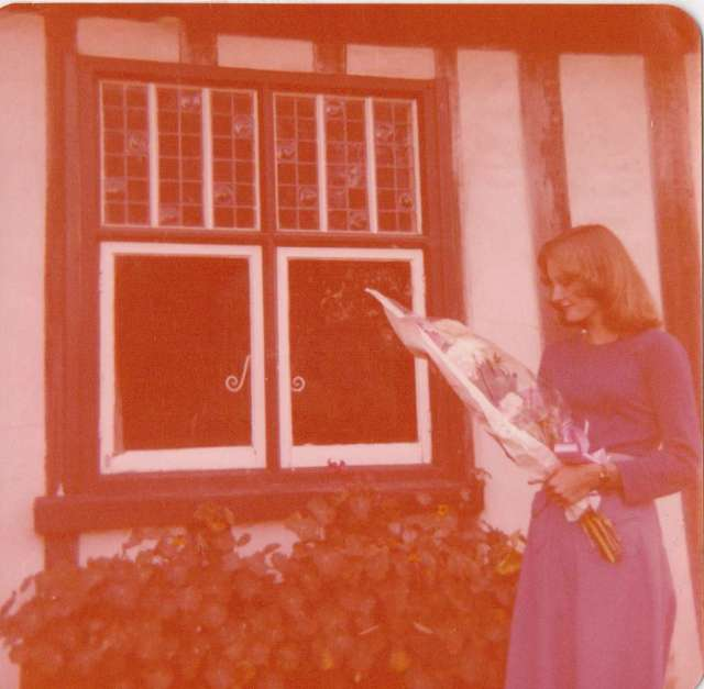 Me outside our home in Suffolk, summer of 1976. with a bouquet of flowers given me by my mum after receiving my O Level results.  This was before I knew what I was in for with my first job.  It made me wonder why I bothered working so hard. Forget A Levels, I wanted to earn money.  Ironic that I ended up taking a full-time college course anyway! (c) Sherri Matthews