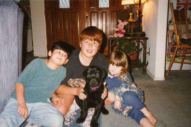 My three kids with our Lab puppy Monty 1990s California (c) Sherri Matthews