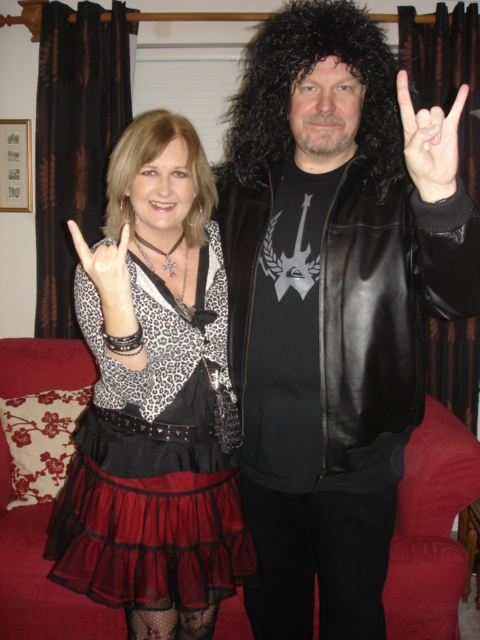 Me with Hubby - Yes, you get to see him at last.  In disguise, haha!  This is a wig in case you were wondering. Now who do you think he looks like?  BTW, he is wearing one of Nicky's t-shirts and I'm wearing my daughter's Goth skirt.   (c) Sherri Matthews 2014