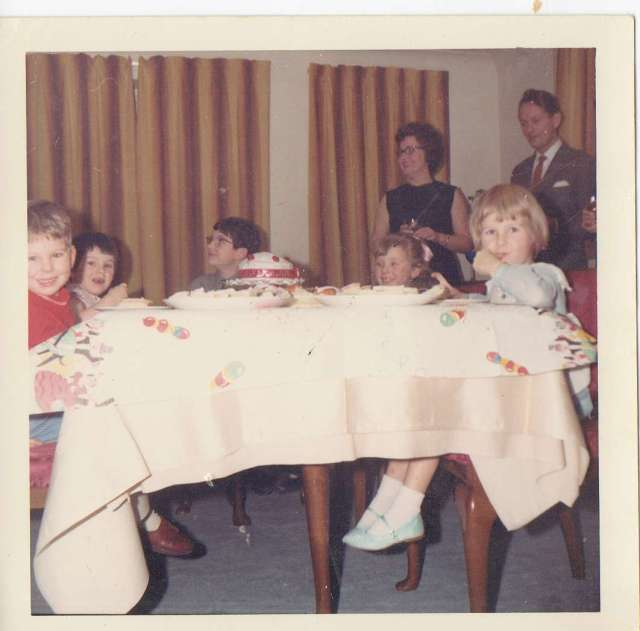 Me, with my brother and cousins (and uncle and auntie in the background) enjoying the party in my party dress and sparkly shoes.  And yes, I do have chocolate on my face!   Mid 1960's (c) Sherri Matthews 2014