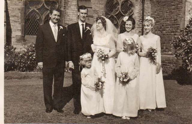 Wedding Photograph.  Me as a five year old directly in front of my uncle with my dad to my left as you look at the photo.  The other bridesmaid that I met at the weekend is the lovely lady behind me with the dark hair, to the right of my auntie. (c) courtesy of Elisabeth Nelson 2014