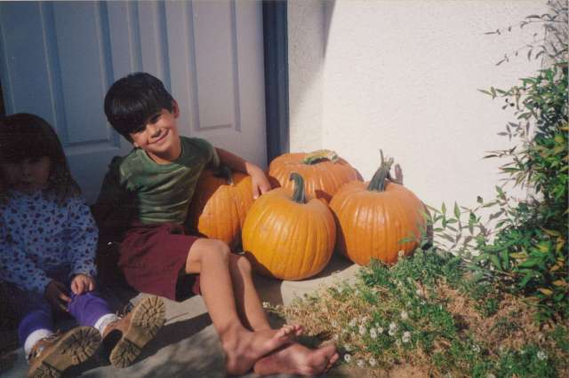 Nicky and home-grown pumpkins on our front porch, California 1990s (c) Sherri Matthews