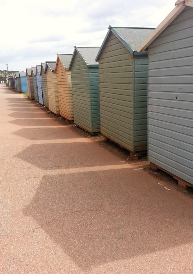 A convergence of beach huts at Budleigh Salterton, Devon, England (c) Sherri Matthews 2014
