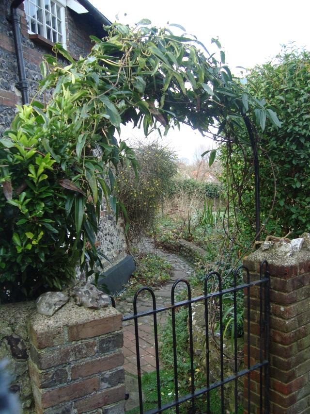 View through the leafy archway above the garden gate to the back garden. (c) Sherri Matthews 2015