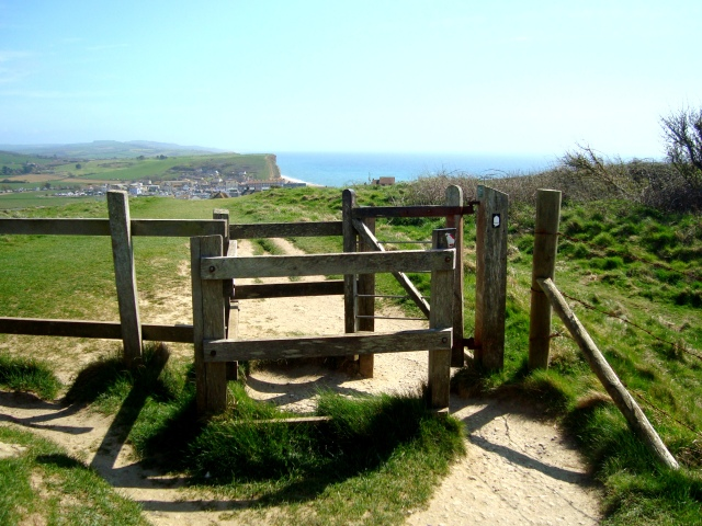 The way ahead looks clear and calm, if we can just have the courage to push through the gate. West Bay, Dorset, England. April 2015 (c) Sherri Matthews