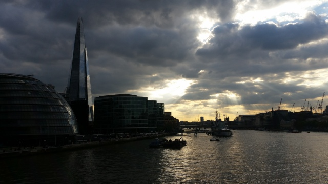View from Tower Bridge, London, of the River Thames with The Shard to the left  and the Post Office Tower in the far distance. Early evening, June 2015 (c) Sherri Matthews