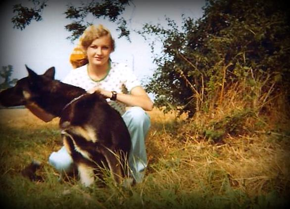 Me with Simon the German Shepherd, Field at the back of our house in Suffolk, July 1974 (c) Sherri Matthews