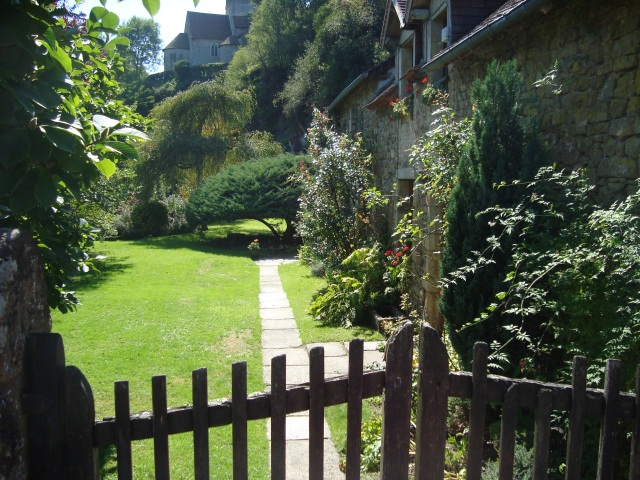 What are the boundaries of your hometown? I would like to open this gate and walk beyond the boundaries of this beautiful house and garden in a village in France...if the owners wouldn't object... (c) Sherri Matthews 2015