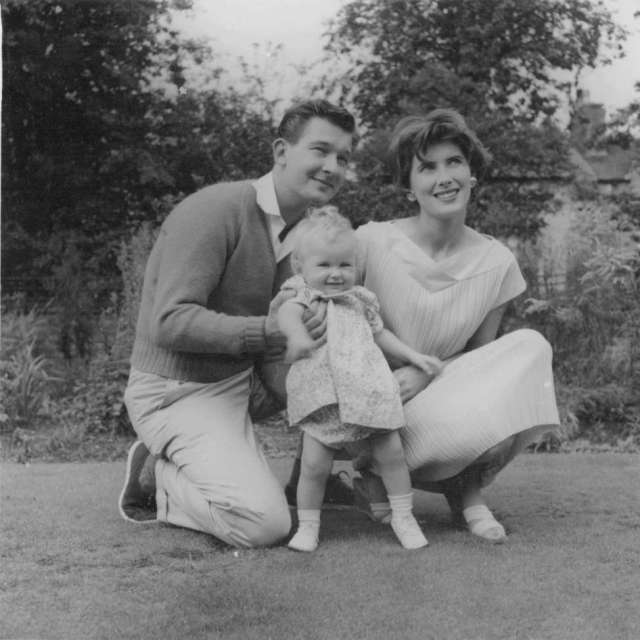 Me with Mum & Dad. Mum knitted Dad's jumper. It was orange. 1960s